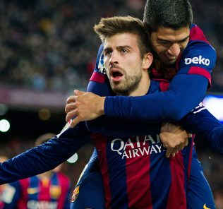 BARCELONA, SPAIN - DECEMBER 07: Gerard Pique (C) of FC Barcelona celebrates with his teammate Luis Suarez after scoring his team's third goal during the La Liga match between FC Barcelona and RCD Espanyol at Camp Nou on December 7, 2014 in Barcelona, Spain. (Photo by Alex Caparros/Getty Images)