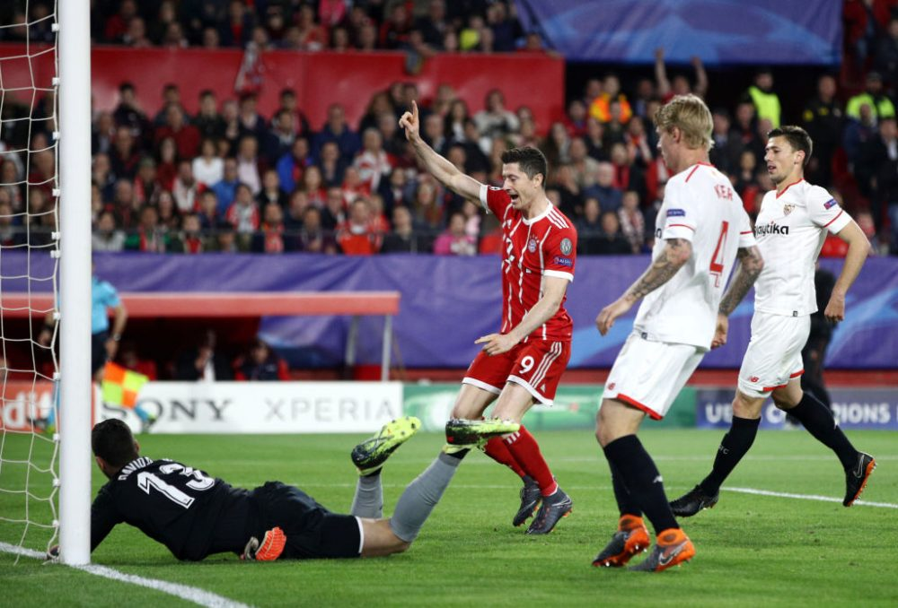 SEVILLE, SPAIN - APRIL 03: Robert Lewandowski of Bayern Muenchen celebrates his sides first goal during the UEFA Champions League Quarter Final Leg One match between Sevilla FC and Bayern Muenchen at Estadio Ramon Sanchez Pizjuan on April 3, 2018 in Seville, Spain.  (Photo by Adam Pretty/Getty Images)